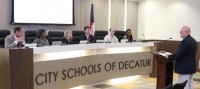 City Schools of Decatur's Chief Operating Officer Noel Maloof announced to the board of education that the district is being recognized for sustainability and green practices. Photo by Travis Hudgons
