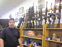 CJI Guns co-owner Ron Moon said he isn't worried about a potential bill in Georgia that could ban assault rifles. Photo by Horace Holloman