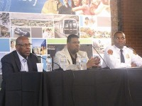 Marcus Kellum, center, director of beautification in DeKalb County, speaks to a crowd of participants as part of a panel discussion during the county's annual DeKalb Neighborhood Summit. Photo by Horace Holloman