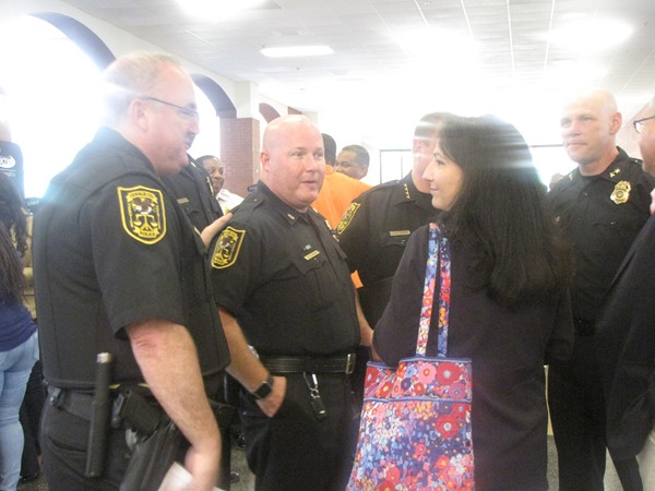 DeKalb County police officers speak with DeKalb County Commissioner Nancy Jester during a public safety summit. Photo by Horace Holloman