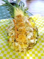 "Grillers served in a ""bowl"" made from a scooped out pineapple are a specialty at Taste Buddz. Photos by Kathy Mitchell"