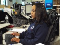 DeKalb County 911 operator Tiara Jackson takes calls from the Tucker operating center. Photos by Horace Holloman