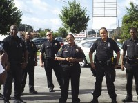 DeKalb County police officers gather at a Dunkin Donuts in support of a fellow officer recently diagnosed with cancer. Photo by Horace Holloman