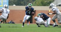 Arabia Mountain quarterback Samad Noble takes an opening. Photos by Travis Hudgons