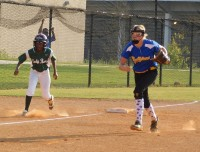 Arabia Mountain's Myia Lewis, left, looks to steal home. Photos by Carla Parker