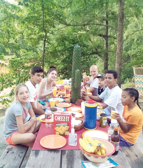 Cousins enjoy dinner by the lake at Bolding Mill Campground.