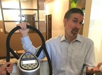 "David Shapiro, chief wellness officer at Complete Spine Solutions, demonstrates a whole body vibrator he calls ""the Cadillac of vibrating machines."""