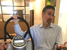 """David Shapiro, chief wellness officer at Complete Spine Solutions, demonstrates a whole body vibrator he calls """"the Cadillac of vibrating machines."""""""