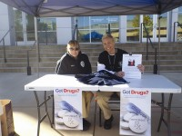 Decatur police officers Amy Hall and Shirley Kersey sit by the police department's drug-take back booth on Oct. 22 for National Prescription Drug Take-Back Day.