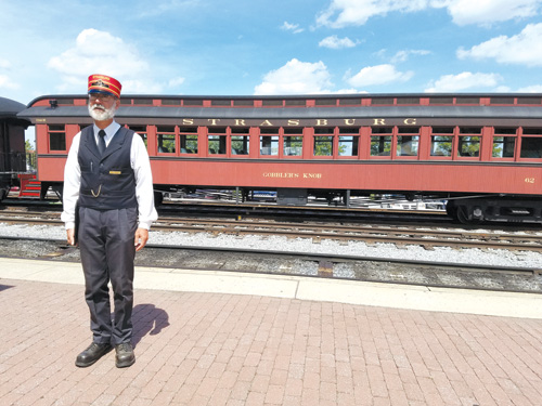 Red cap Joel provides information to guests of the Strasburg Rail Road before they board the train. Photos by Gale Horton Gay