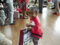 Destiny Lott, 3, is all smiles after receiving a gift from the employees at the DeKalb Sheriff's Office.
