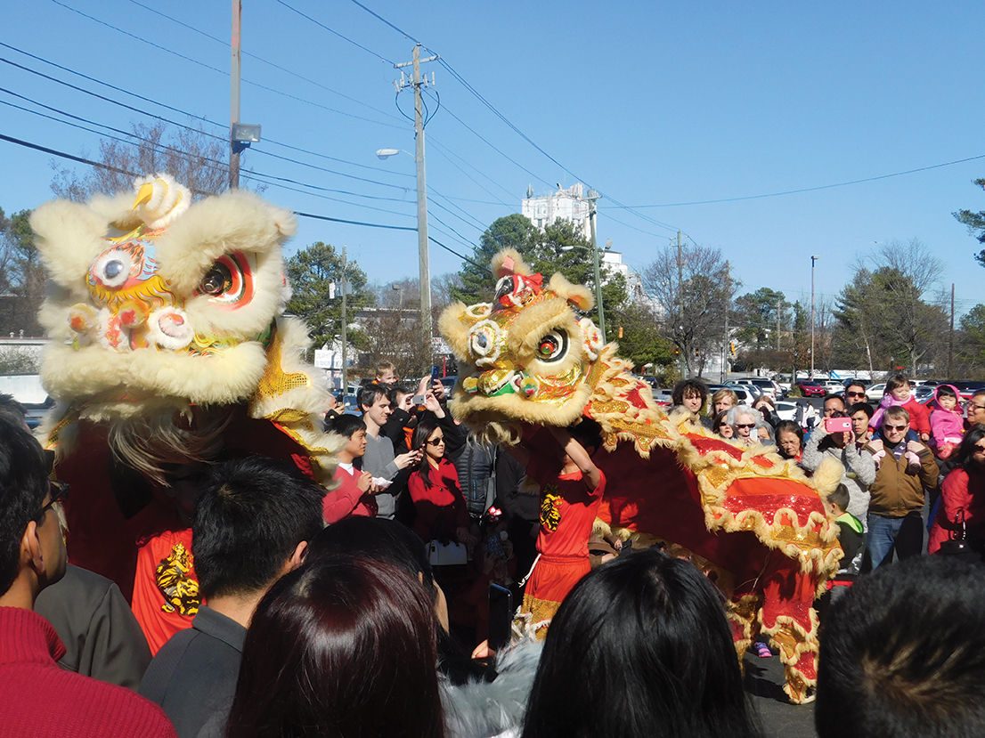 The Chinese New Year celebration featured four performances of the lion dance, which symbolizes a community approaching good fortune. Photo by R. Scott Belzer