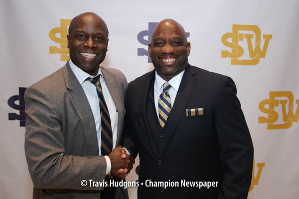 Southwest DeKalb PrincipalDr. Thomas Glanton, left, and new football coach Damien Wimes