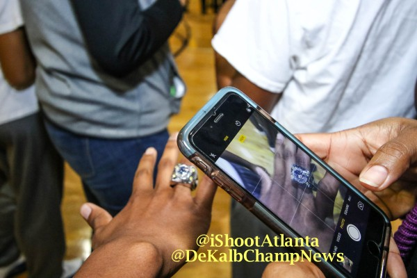 "The durilium ring has four yellow diamonds in each corner on top of the ring, along with the words ""state champions"" and ""2016"" on the outside and the school's logo on top of a basketball in the center."