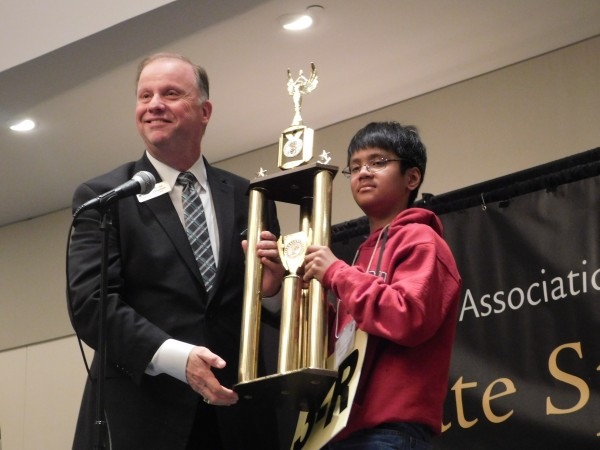 Burnette Elementary School student Abhiram Kapaganty won the 56th Annual Georgia Association of Educators State Spelling Bee and a place at the Scripps National Spelling Bee in Maryland in May, representing Georgia. Also pictured, Sid Chapman of Georgia Association of Educators. Photo by R. Scott Belzer