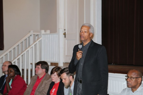 Representative Hank Johnson talks to a group of individuals at the Clarkston Community Center Feb. 12.