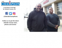 Brandon Cooper, right, and Precision Auto Care shop manager Carl Pierre-Louis stand outside the shop before work.