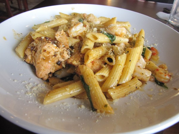 Seafood medley with shrimp, grilled salmon and crawfish over pasta with a creole spicy sauce is the specialty of the day on a menu that features lots of seafood offerings.