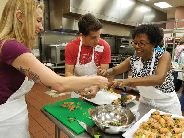 Donna Satchell Kimble, right, and her teammates assemble a smoked salmon appetizer.