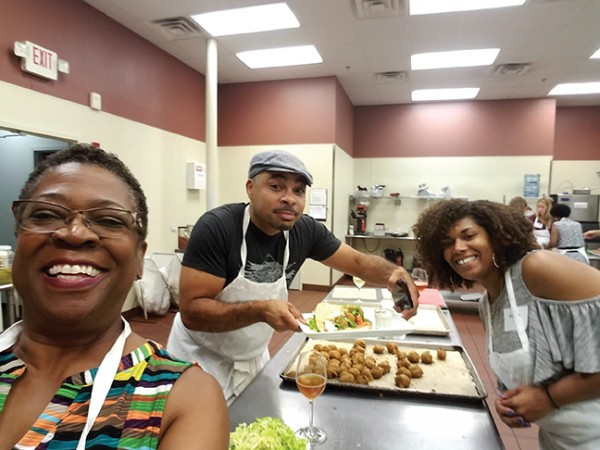 Gale Horton Gay, left, with team members Dennis Malcolm Byron and Andrea ham it up while working on a falafel dish.
