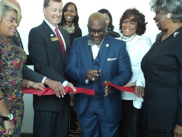 Commissioner Gregory Adams cuts the ribbon at his first event March 23 at the Porter Sanford III Performing Arts and Community Center in Decatur.