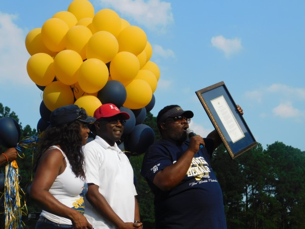 As part of the Southwest DeKalb Alumni Association's seventh annual alumni cookout, DeKalb County commissioner Larry Johnson officially designated Aug. 5, 2017 as Southwest DeKalb Day in DeKalb County. Pictured: Johnson, Southwest DeKalb Alumni Association president Danny Davison and Southwest DeKalb principal Thomas Glanton. Photo by R. Scott Belzer
