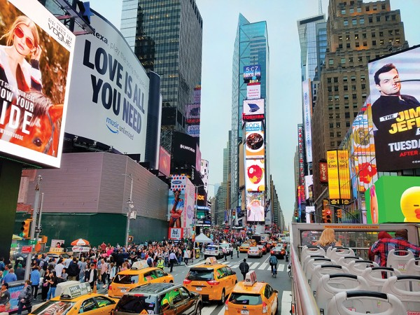 The rush of Times Square, top, and the stateliness of the Metropolitan Museum of Art are two of the many sights to be seen on the double decker bus tours in New York City. Photos by Gale Horton Gay
