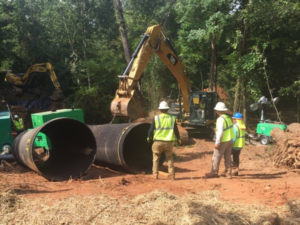 DeKalb County workers make repairs at the site of a major spill at Snapfinger Creek in the unincorporated Lithonia area.