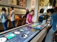 An interactive display table allows visitors to select music to be played and read about musical artists.