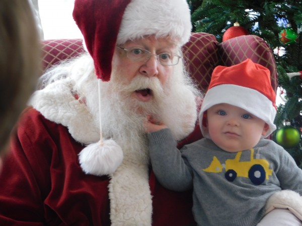 Eight-month-old Byrne Culpepper reacts to seeing Santa for the first time.