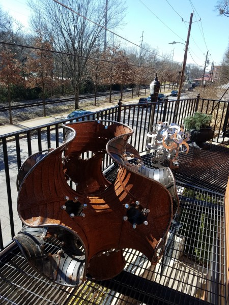 Metal sculptures are showcased on the balcony of Different Trains Gallery.